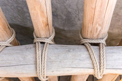 Rope tied around wooden fence pole Stock Photography