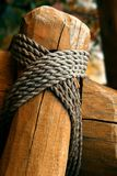 Rope tied around a wooden fence pole; shallow DOF Stock Photos