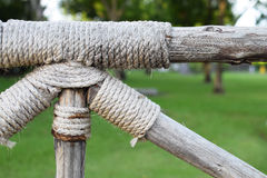 Rope tied around a wooden log Royalty Free Stock Photo