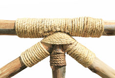 Rope tied around a wooden log Stock Photos