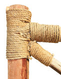 Rope tied around a wooden log Stock Photo