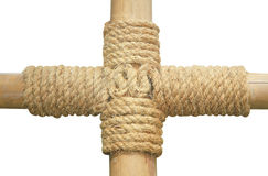 Rope tied around a wooden log Royalty Free Stock Image