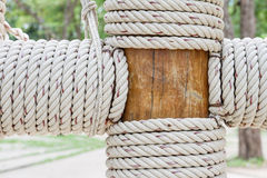 Rope tied around wooden pillar Royalty Free Stock Image
