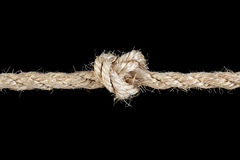 Rope tied in a knot Stock Image