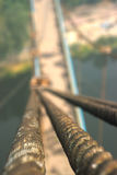 Rope with tied knot of a hanging bridge Royalty Free Stock Images