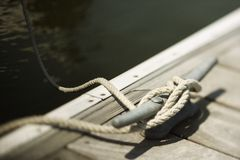 Free Rope Tied To Cleat On Dock Stock Photography - 2051532