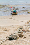 Rope tied to a fishing boat on the beach. Royalty Free Stock Photos