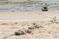 Rope tied to a fishing boat on the beach. Stock Photo