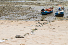 Rope tied to a fishing boat on the beach. Stock Images