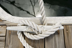 Rope tied to a jetty cleat Royalty Free Stock Photo