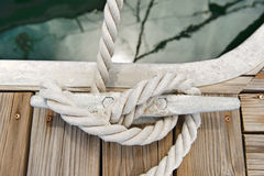 Rope tied to a jetty cleat Stock Photo