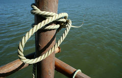 Rope tied to a marine pole Stock Photography