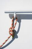 Rope tied to a railing Stock Photo