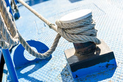 Rope tied to steel bollard Royalty Free Stock Image