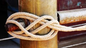 Rope tied to the steel pipe royalty free stock images