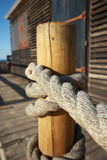 Rope tied to a wooden pole Stock Photo