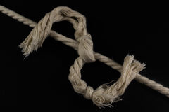 Rope Tied Together in a Frayed Knot Royalty Free Stock Photo
