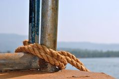 Rope tightened with boat clamp with beautiful view of lake in backgrounds Stock Photo