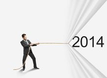 Rope to 2014. Businessman pulling rope to 2014 stock illustration