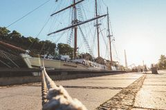 Rope to moored ship at the light of sunrise royalty free stock images
