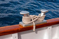 Rope and two-headed mooring bitt. Rope and mooring bitt on board the boat Royalty Free Stock Photos