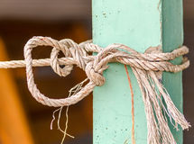 The rope tying with pole mortar Stock Photography
