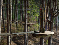 Rope Walk. High wire forest adventure course of rope bridges, Swings and slides Stock Image