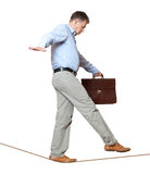 Rope-walker. Businessman rope-walker. Isolated on white background Royalty Free Stock Images