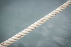 Rope with water surface. Background Royalty Free Stock Photo