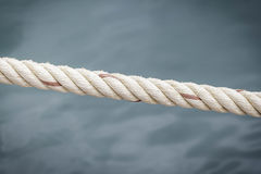 Rope with water surface. Rope with water surface background at the river Stock Image