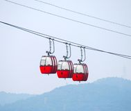 Rope-way. Three red cabins Stock Photography