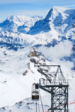 The rope way lift station on snow mountain, Jungfraujoch Royalty Free Stock Photography