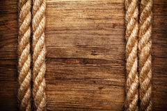 Rope on weathered wood. Background stock photo