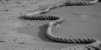 Rope on a Wet sand Royalty Free Stock Photos