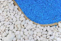 Rope between white and blue stones for background Stock Images