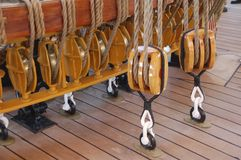 Rope wires and pulleys of a ship. Rope wires and pulleys of a sailing boat on its deck Stock Photo