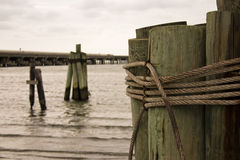 Rope and Wood. A rope bound mooring at the water's edge in the Outer Banks of North Carolina Royalty Free Stock Photos