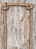 Rope and wood background Stock Images