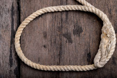 Rope on a wood desk Royalty Free Stock Photo