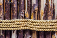 The rope and wood. The strong ropes tie around the  wood lump Royalty Free Stock Image