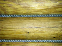 Rope and wood texture. Wood trunks with ropes between them Royalty Free Stock Images