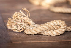Rope on a wooden background Stock Images