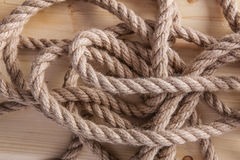 Rope on wooden board Royalty Free Stock Image