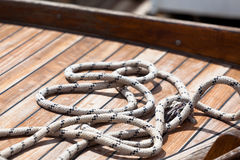 Rope on a wooden boat deck Royalty Free Stock Photo