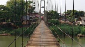 Rope wooden bridge to village Royalty Free Stock Image