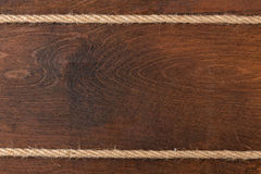 Rope on wooden dark  background Stock Photography