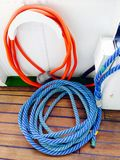 Rope on wooden deck in passenger ship Stock Photography