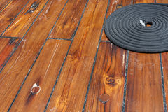 Rope on wooden deck Royalty Free Stock Photography