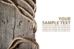 Rope on wooden log Stock Images