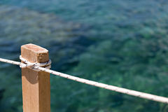 Rope on the wooden pole Stock Photos
